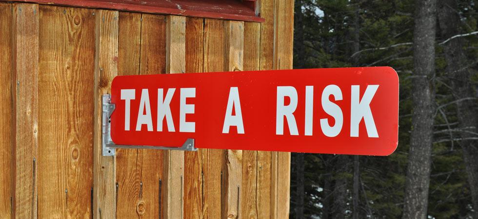 take-a-risk-motivational-sign